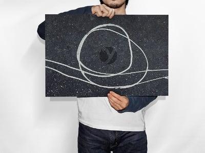 Man Holding Horizontal Poster PSD Mockup